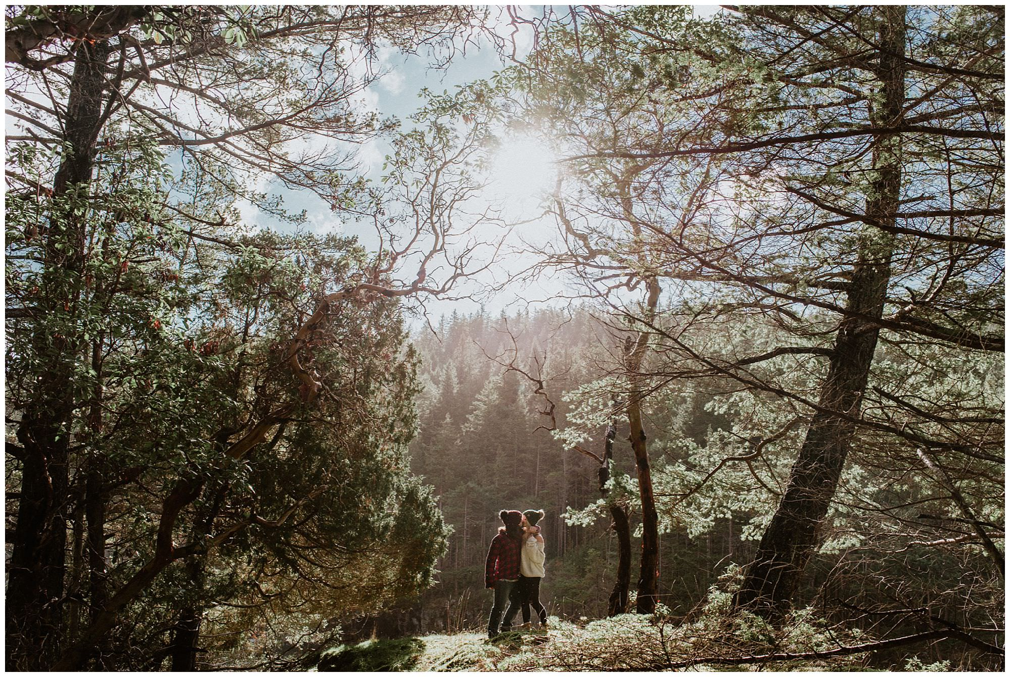 backlit couple in forest on Thormanby Island