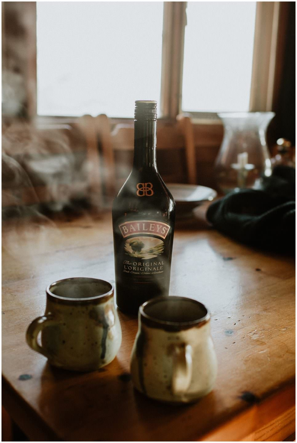 coffee and Baileys in rustic cabin engagement session