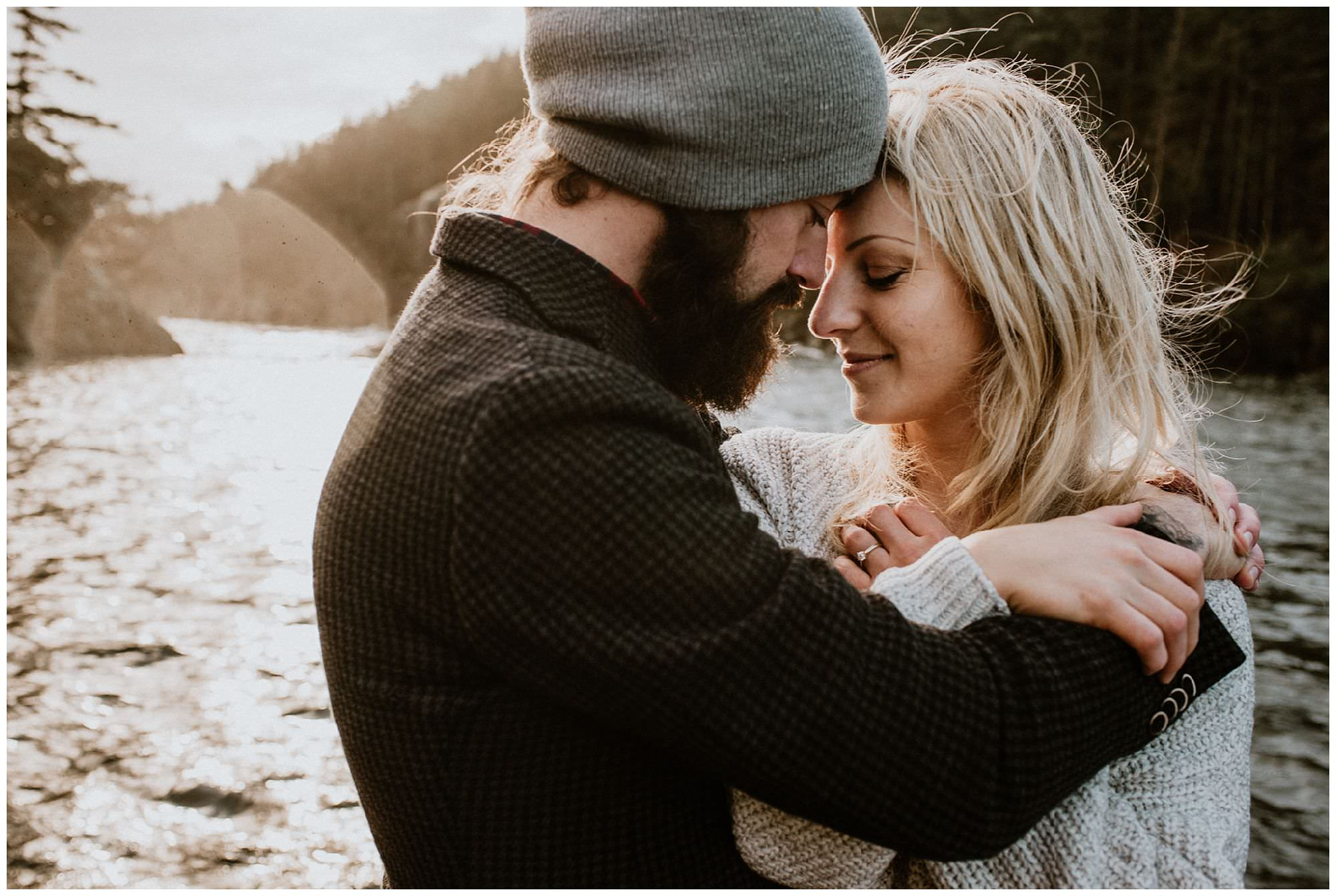 couple cuddling during sunrise engagement session on Thormanby Island