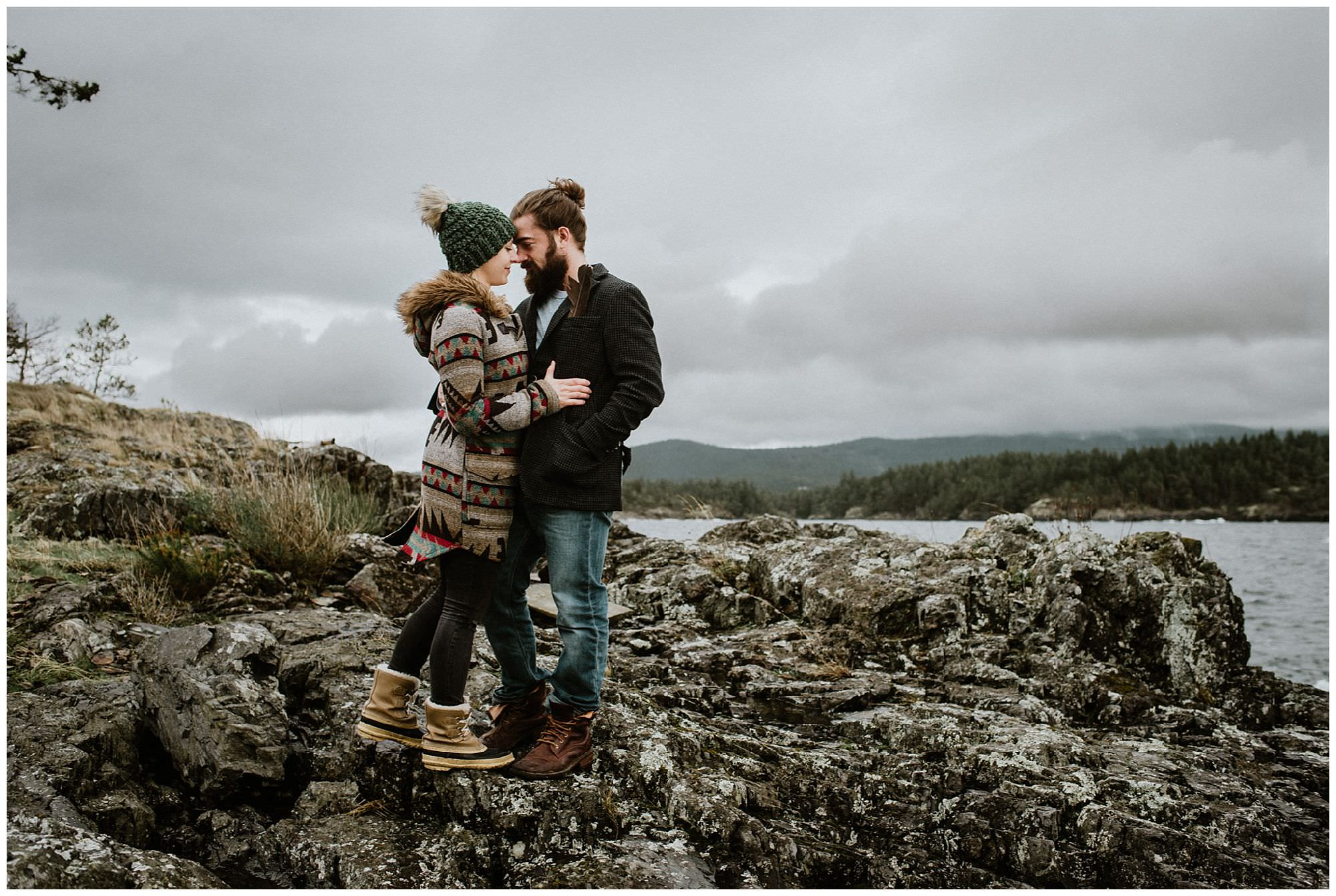 couple in rain boots on rocky beach on Thormanby Island