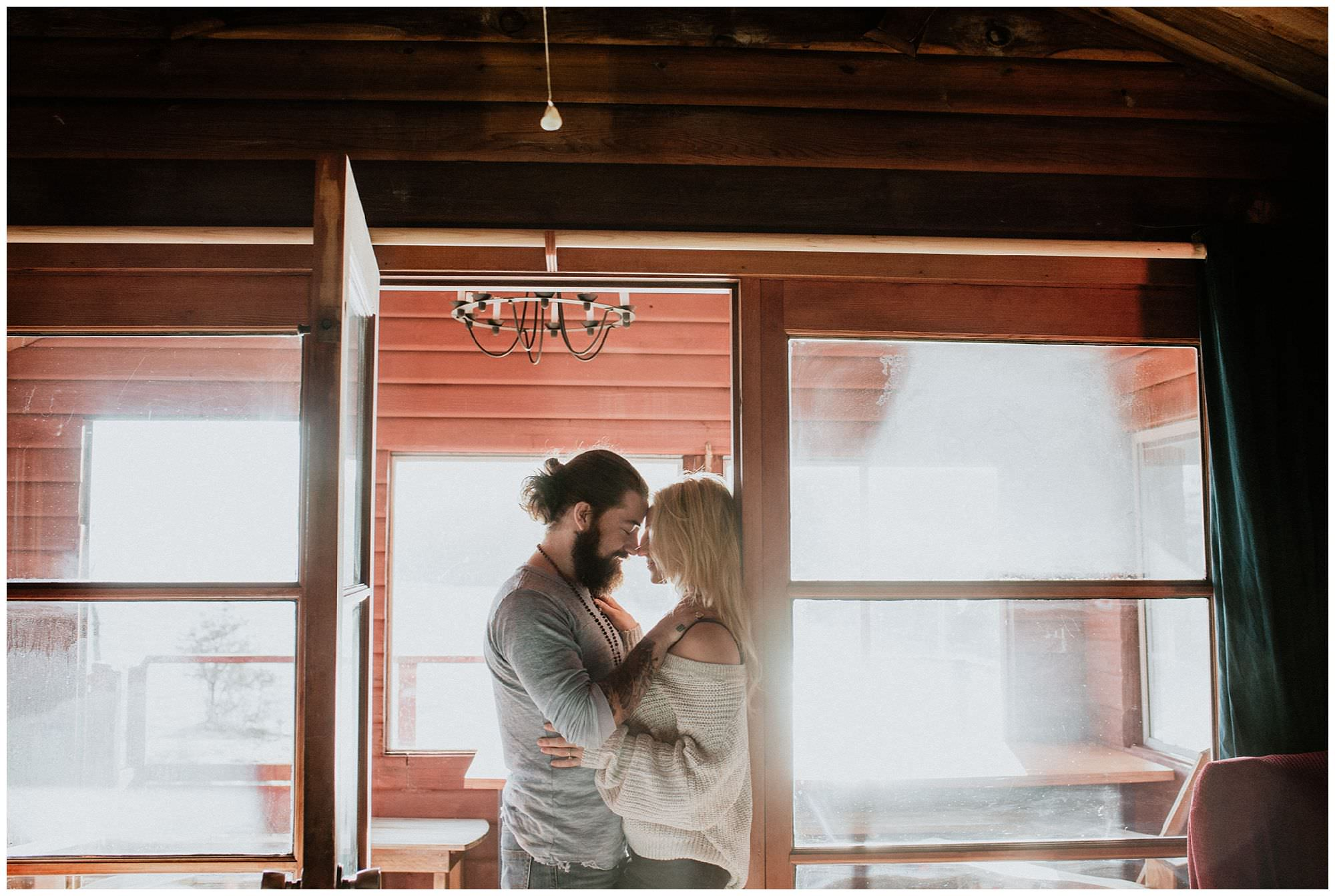 couple in rustic cabin during Thormanby Island engagement session