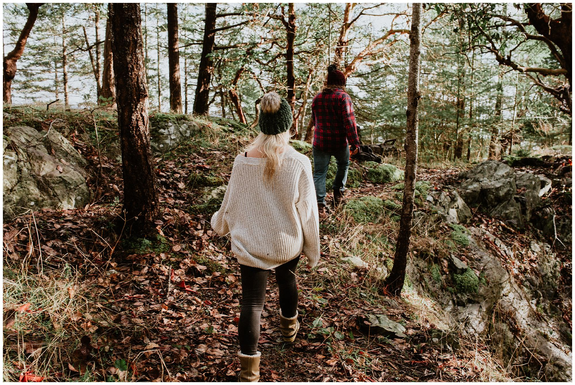 couple walking through forest on Thormanby Island