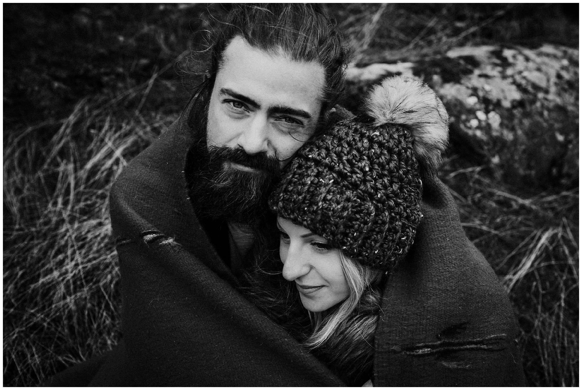 handsome man cuddling woman wrapped in blanket on Thormanby Island