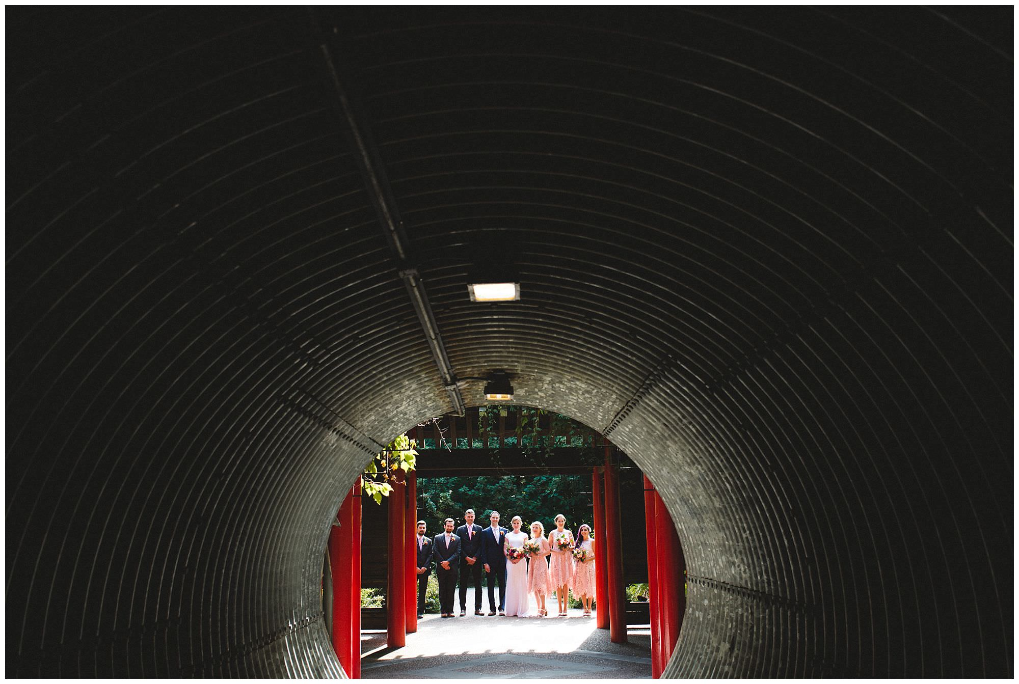 bridal party in tunnel at UBC Botanical Garden wedding