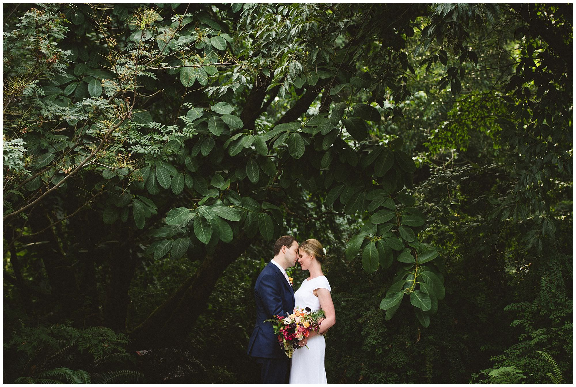 bride and groom candid moment at UBC Botanical Garden wedding