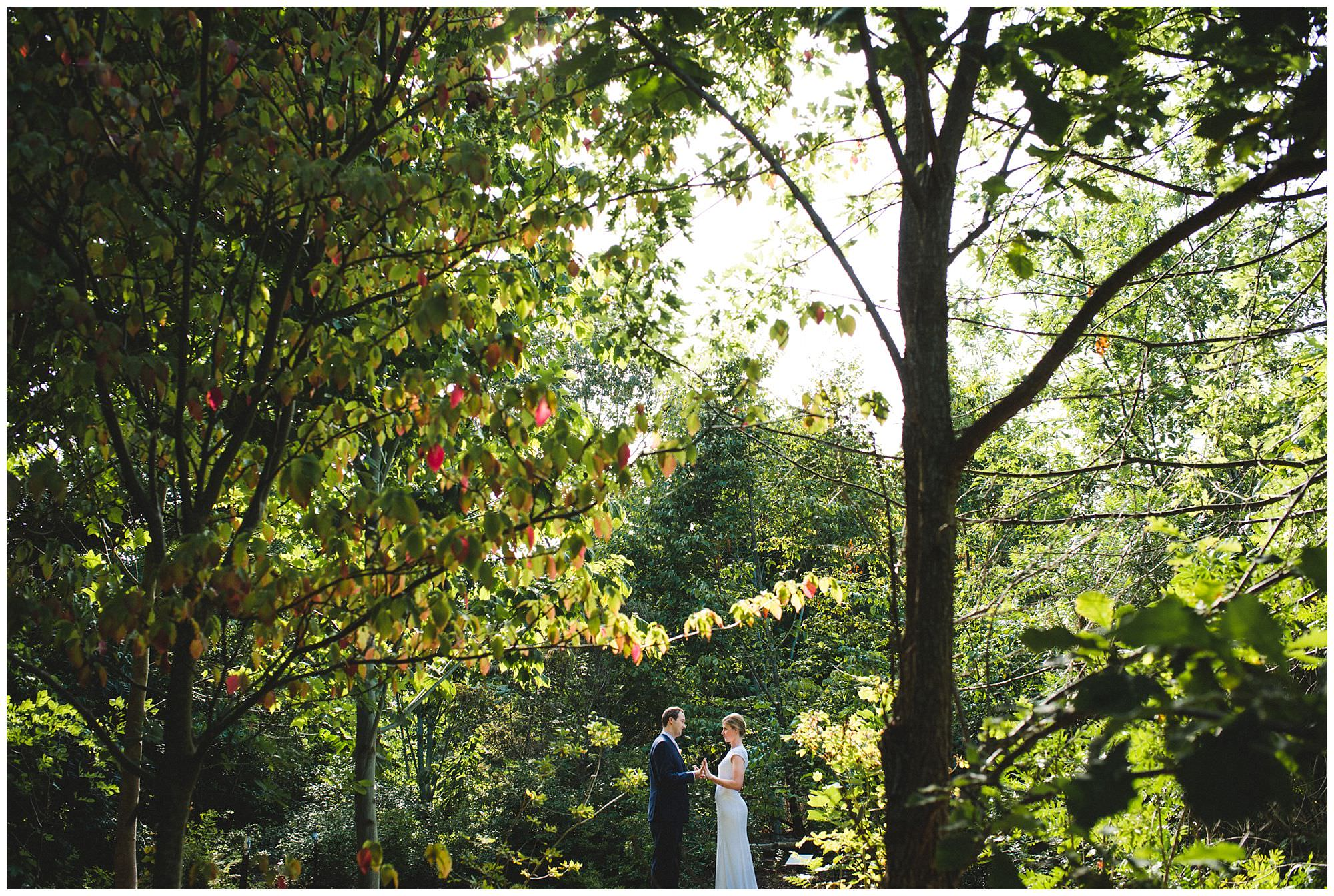 bride and groom in forest at UBC Botanical Gardens
