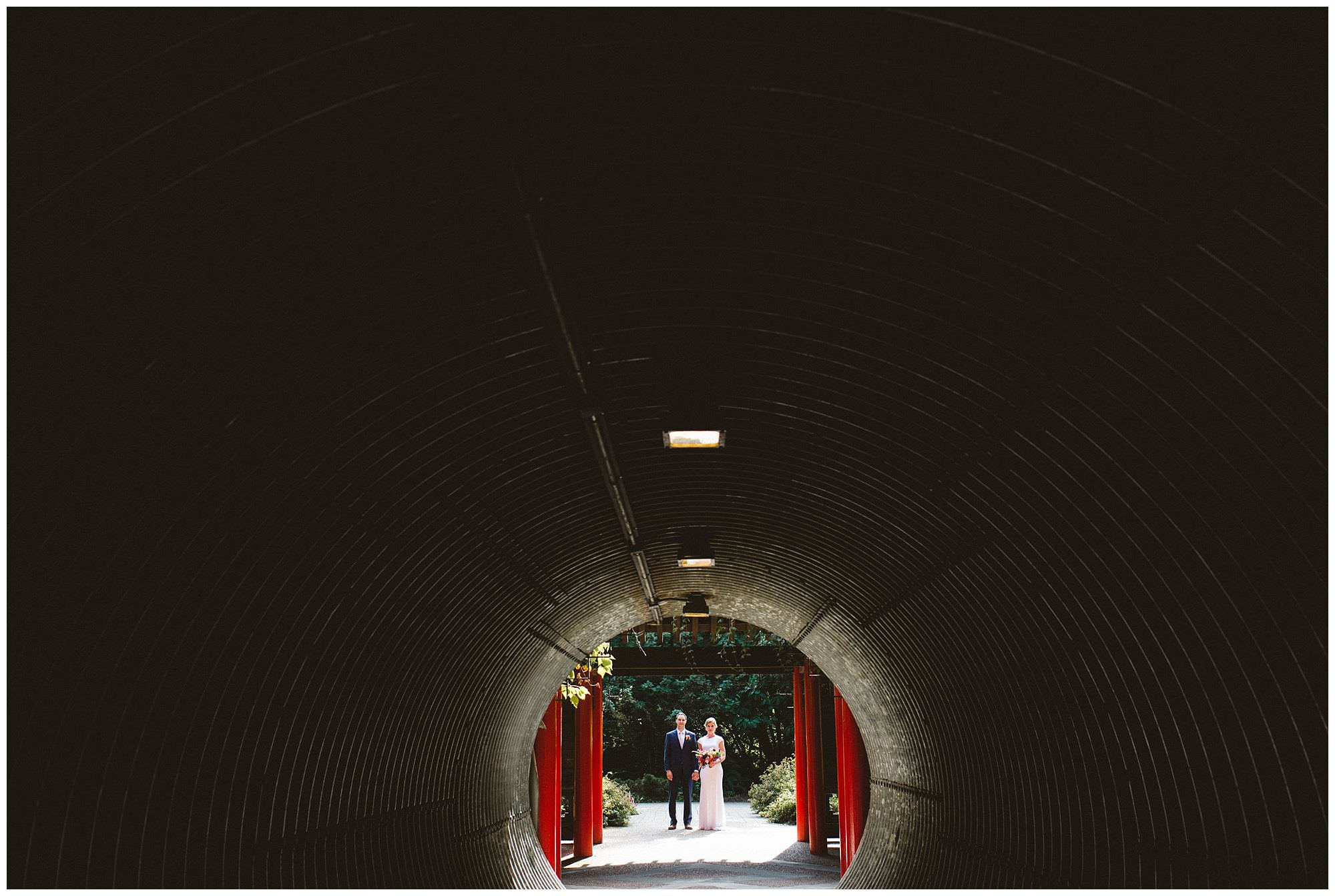 bride and groom in tunnel at UBC Botanical Garden wedding