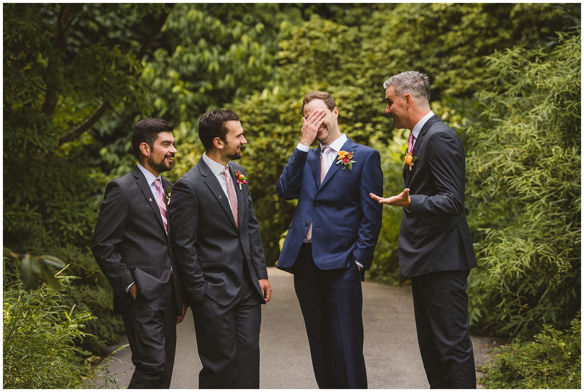 candid moment with groomsmen at UBC Botanical Garden