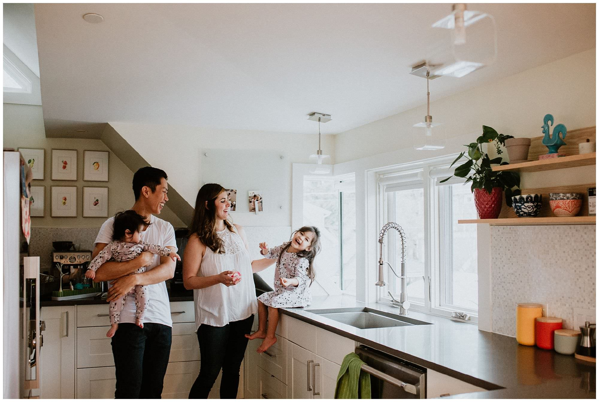 family-laughing-in-kitchen-Vancouver-lifestyle-session