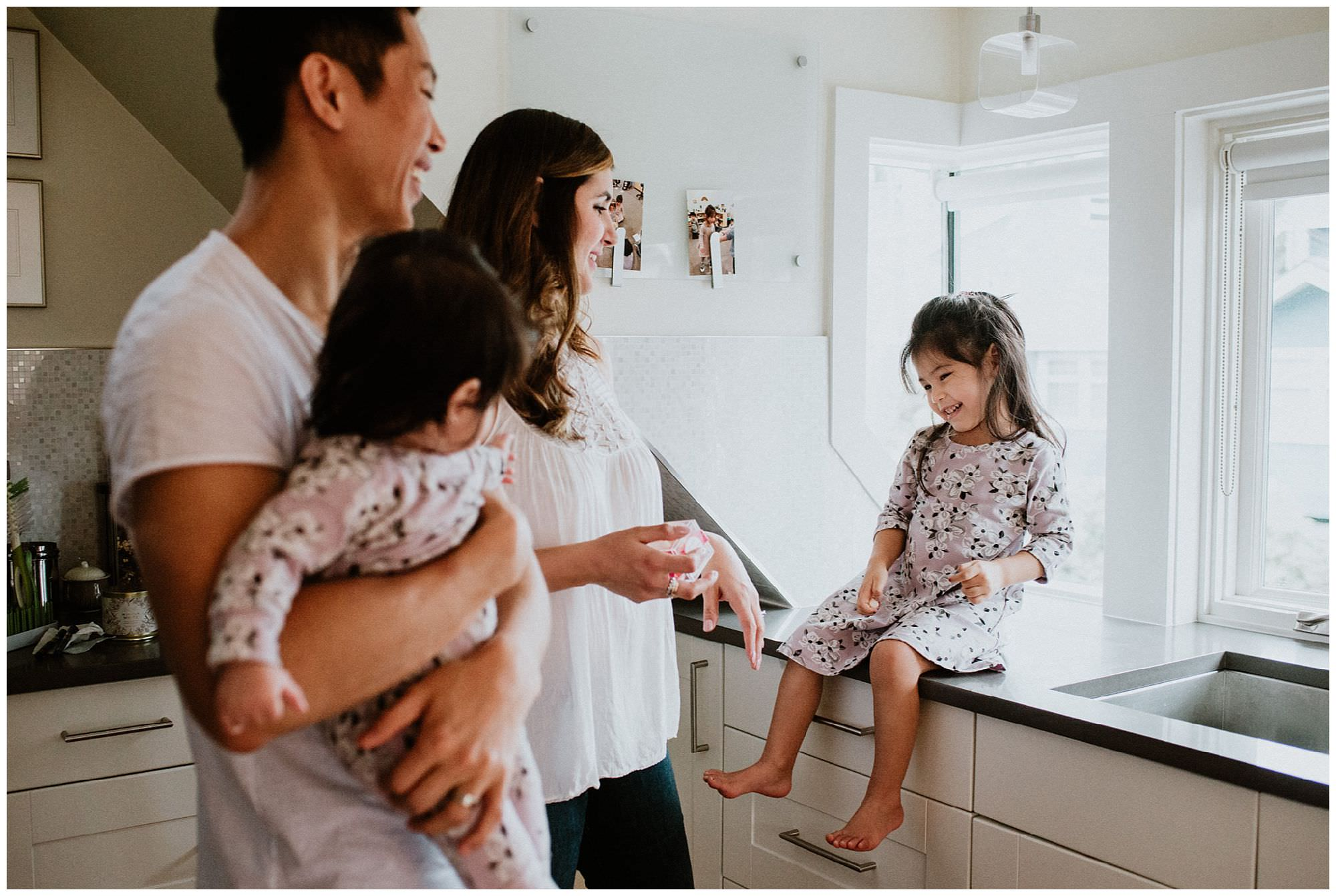 girl-laughing-in-kitchen-Vancouver