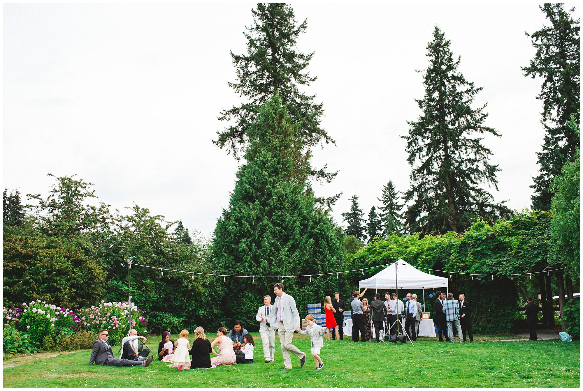 outdoor wedding reception guests at UBC Botanical Gardens