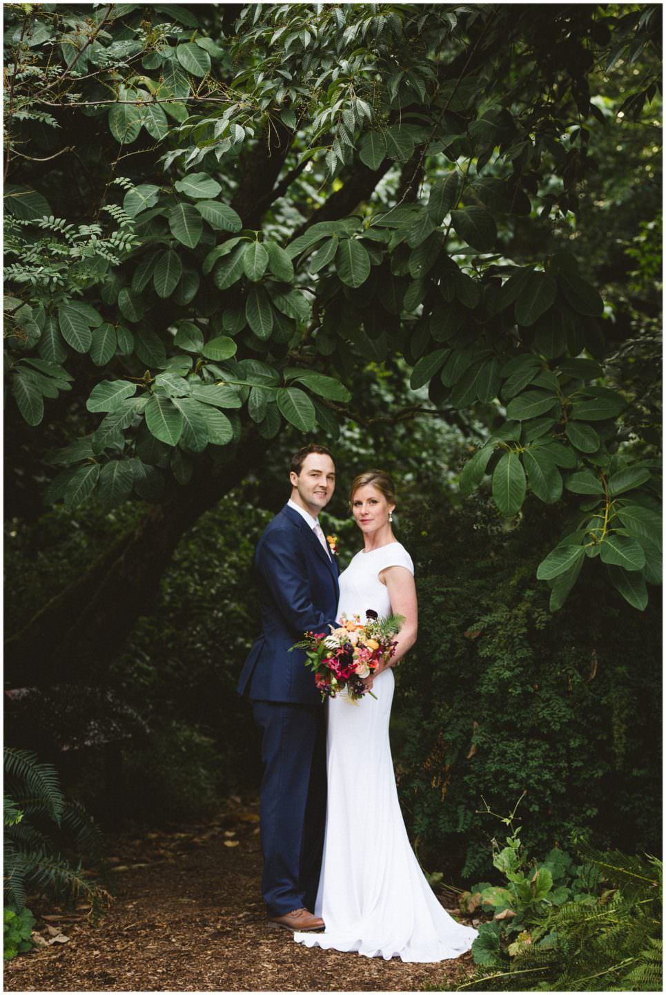 portrait of bride and groom in forest at UBC Botanical Garden wedding