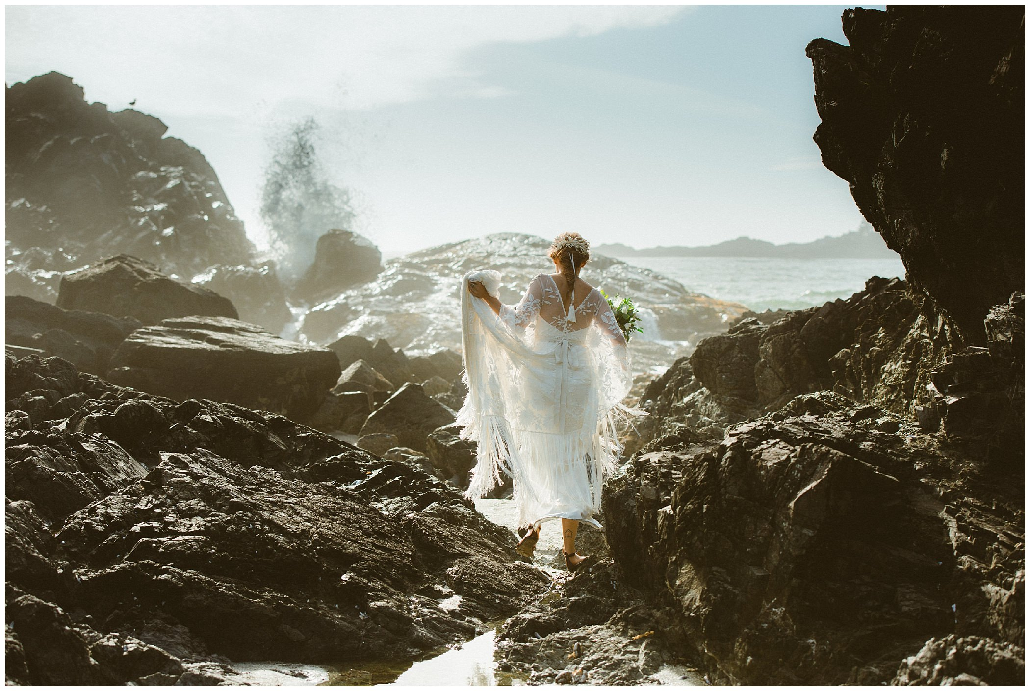 bride walking through rocks during beach wedding in Tofino at Pacific Sands resort, Tofino wedding photographer Ronnie Lee Hill