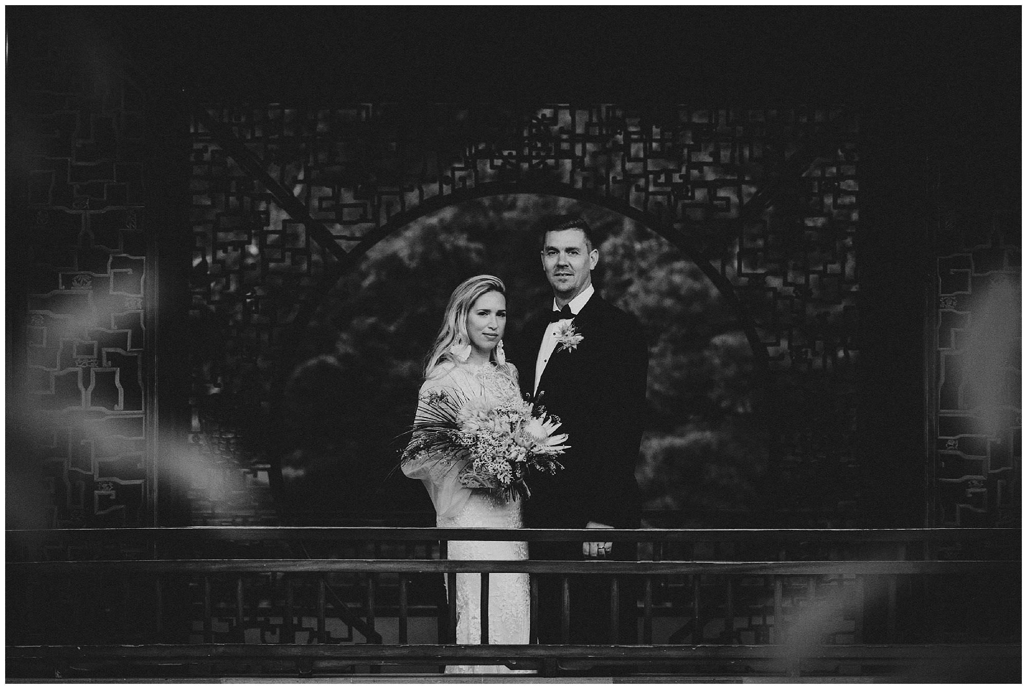 Bride and Groom at sunset after their wedding ceremony at Dr. Sun Yat-Sen Classical Chinese Gardens, elopement, intimate wedding, black and white wedding photography