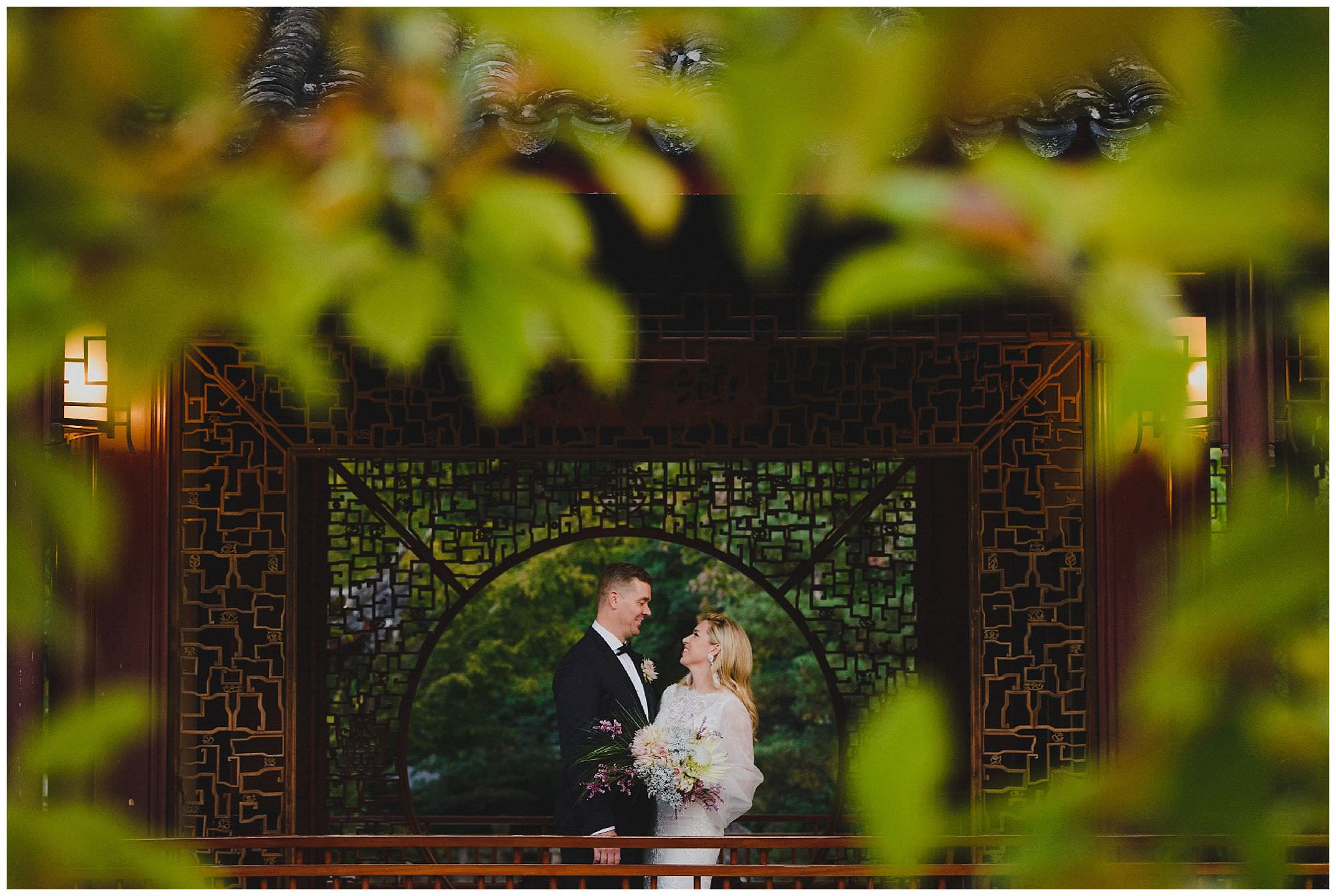 Bride and Groom laughing at sunset after their wedding ceremony at Dr. Sun Yat-Sen Classical Chinese Gardens, elopement, intimate wedding, candid wedding photography