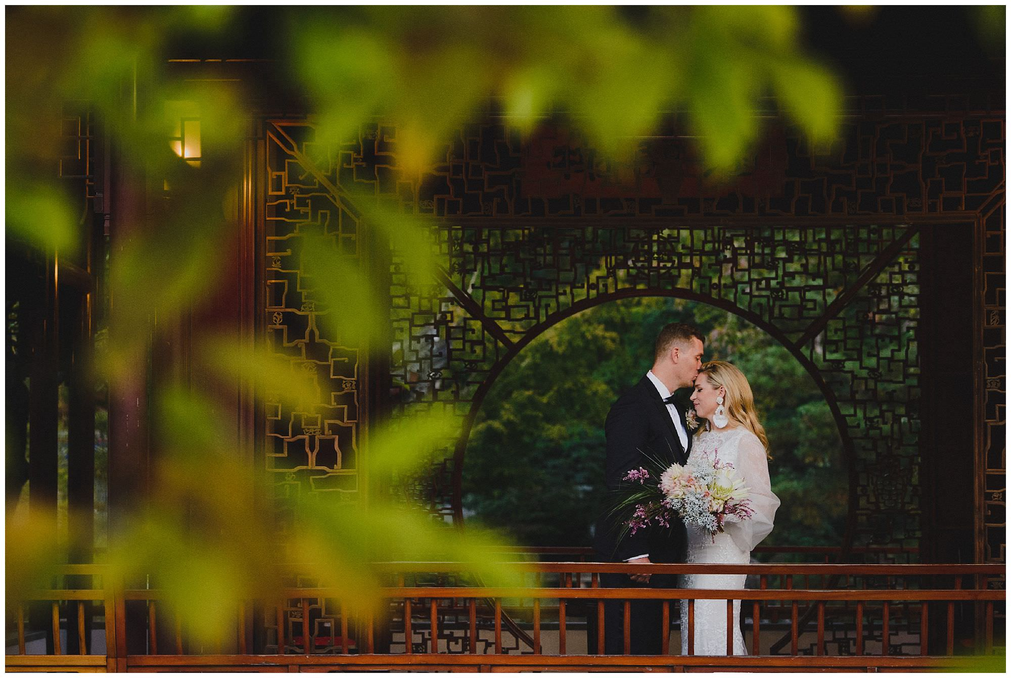 Bride and Groom kiss at sunset after their wedding ceremony at Dr. Sun Yat-Sen Classical Chinese Gardens, elopement, intimate wedding, candid wedding photography