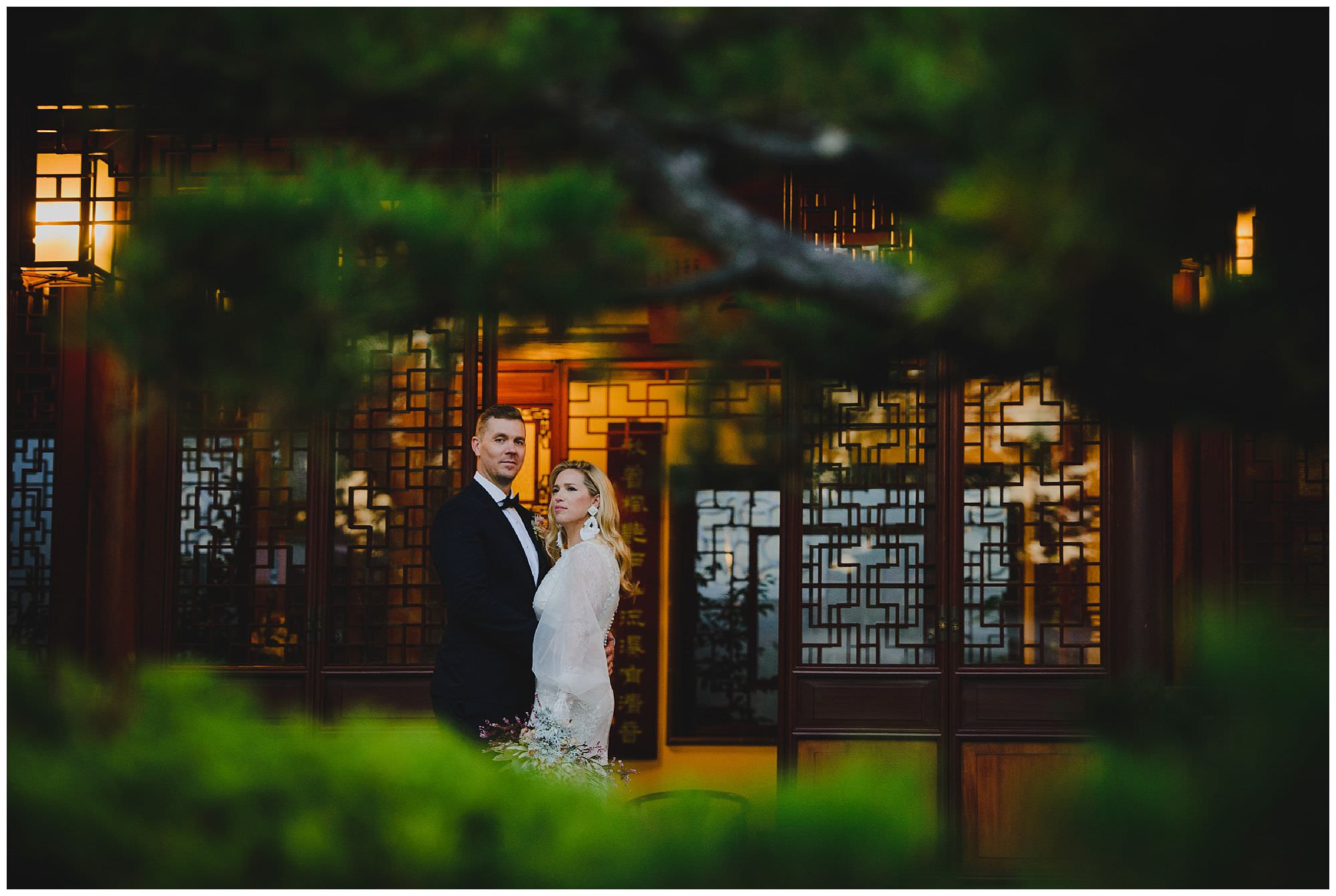 stylish bride and groom at sunset after their wedding ceremony at Dr. Sun Yat-Sen Classical Chinese Gardens, elopement, intimate wedding, candid wedding photography