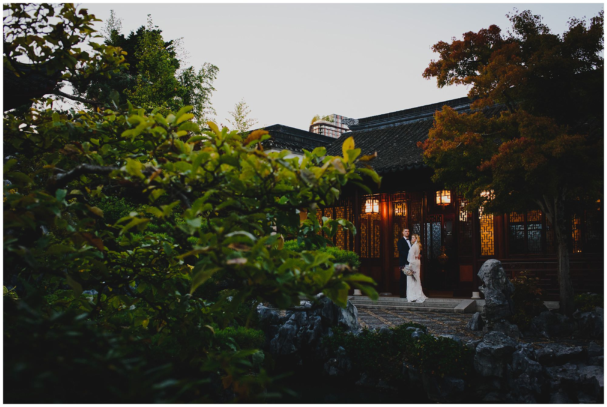 stylish bride and groom at sunset after their wedding ceremony at Dr. Sun Yat-Sen Classical Chinese Gardens, elopement, intimate wedding, candid wedding photography, downtown Vancouver wedding photo