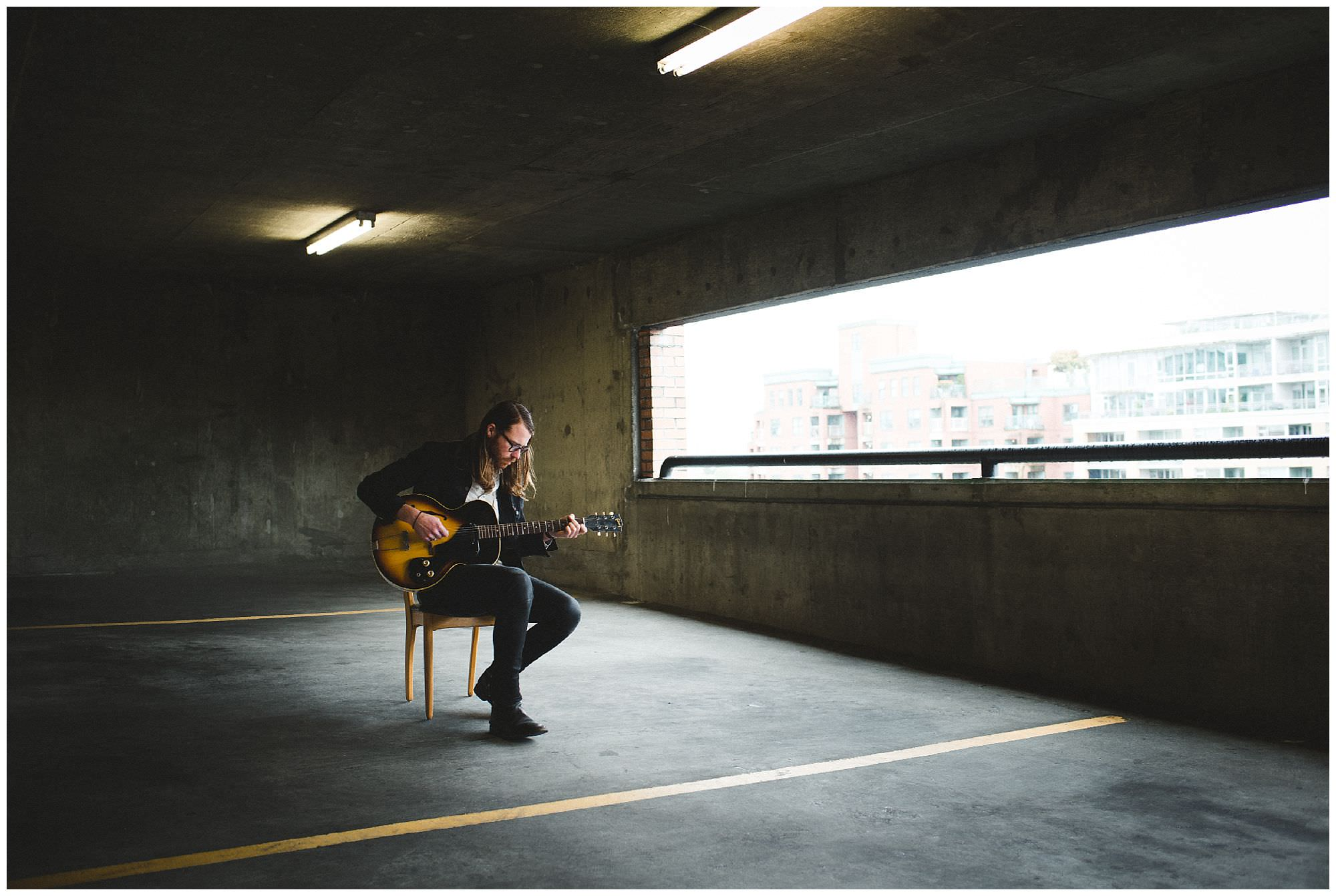 Vancouver musician Matt Kelley plays guitar in parking garage in East Vancouver by music photographer Ronnie Lee Hill