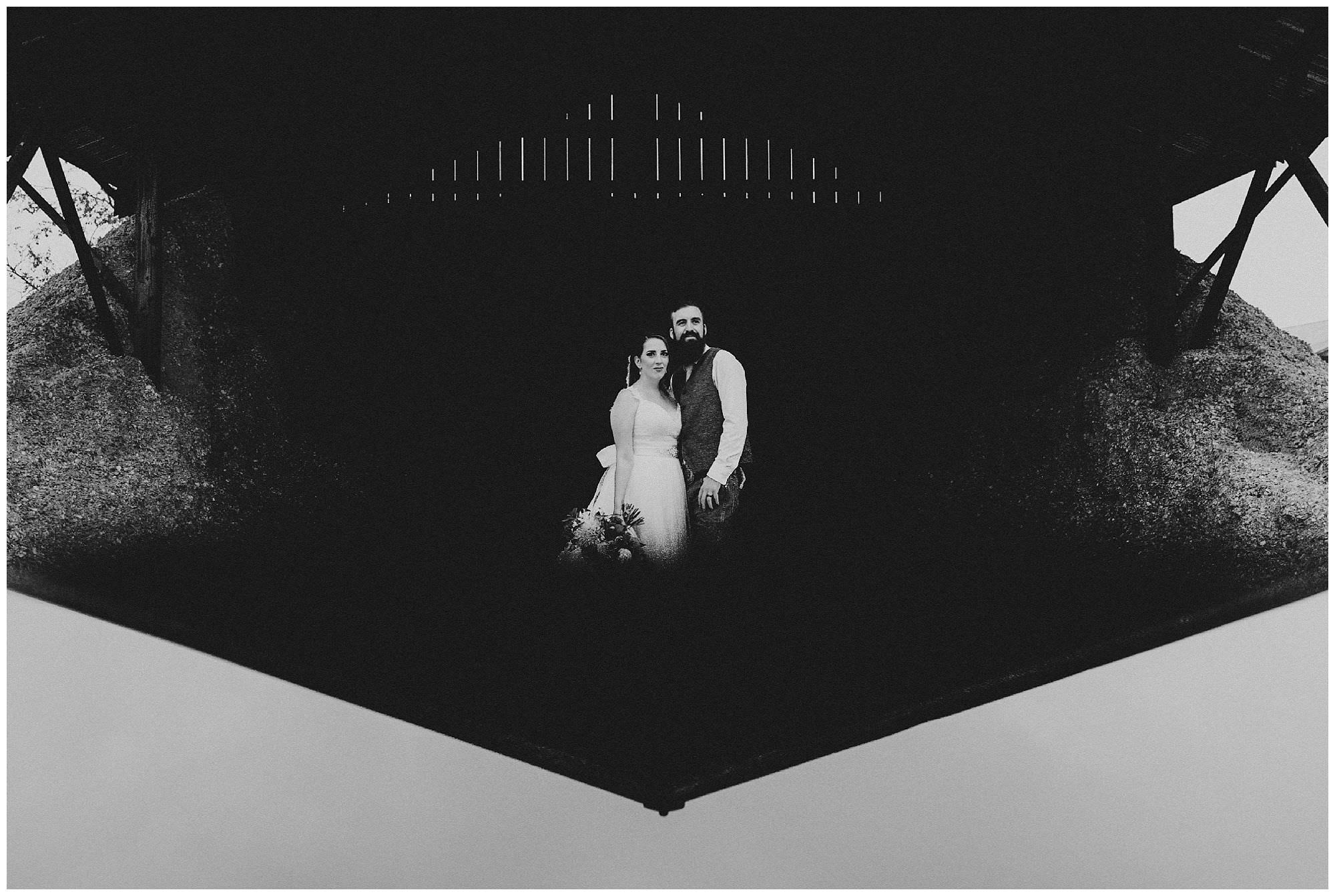 non traditional black and white portrait of bride and groom in barn using iPhone reflection, country wedding at Hopcott Farms BC