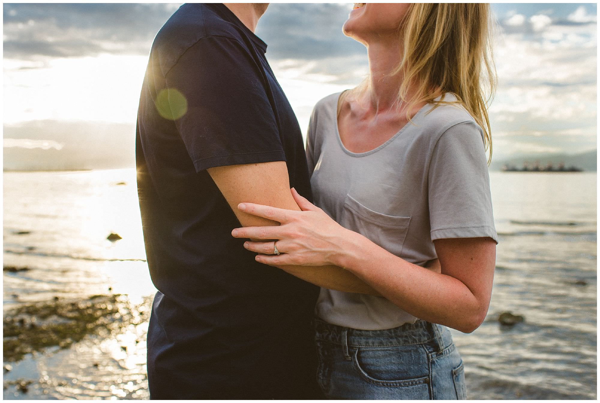 Sunset engagement session at Jericho beach, couple touching, candid moment with couple