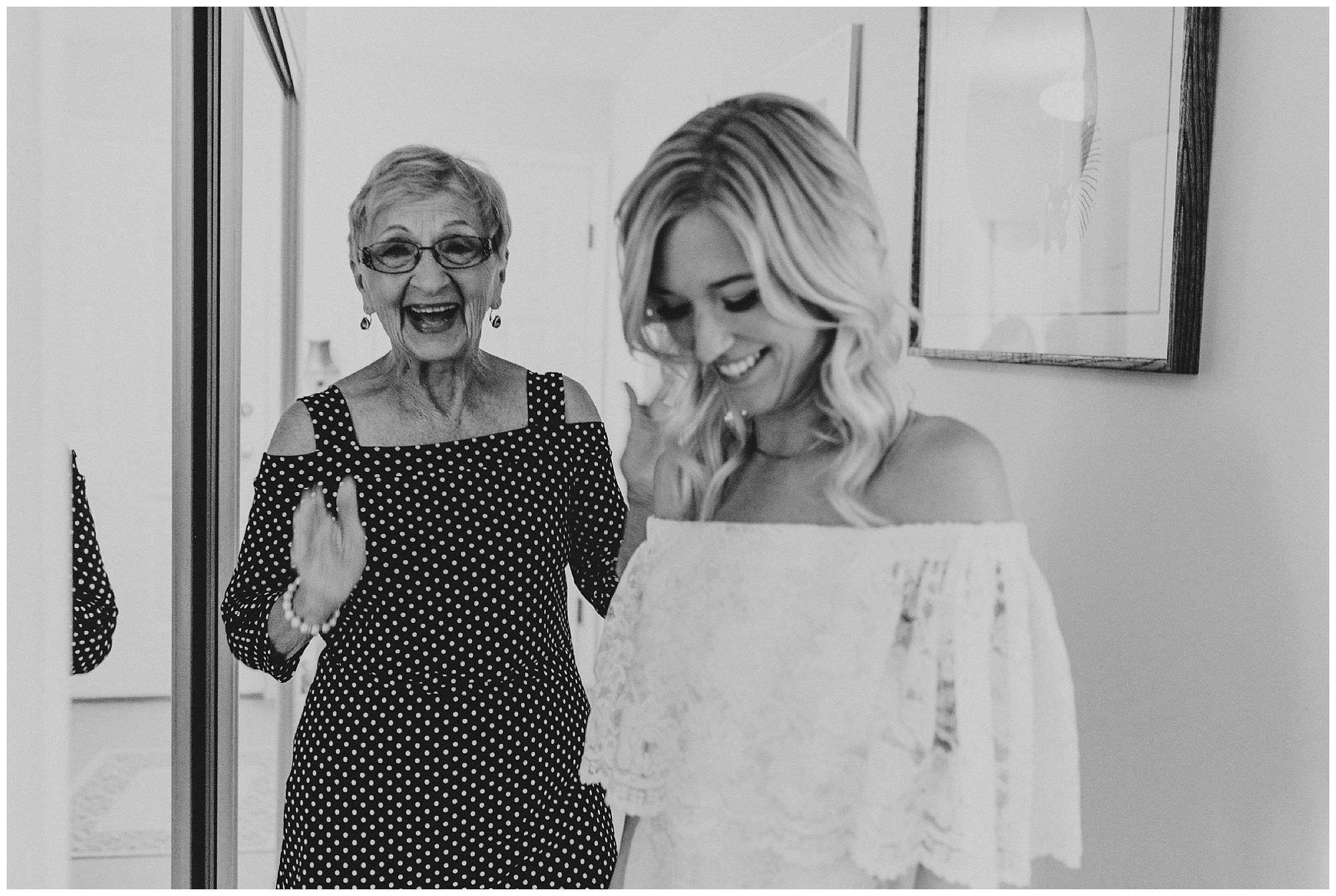 Boho bride and grandma in a candid moment before her Kelowna BC backyard wedding