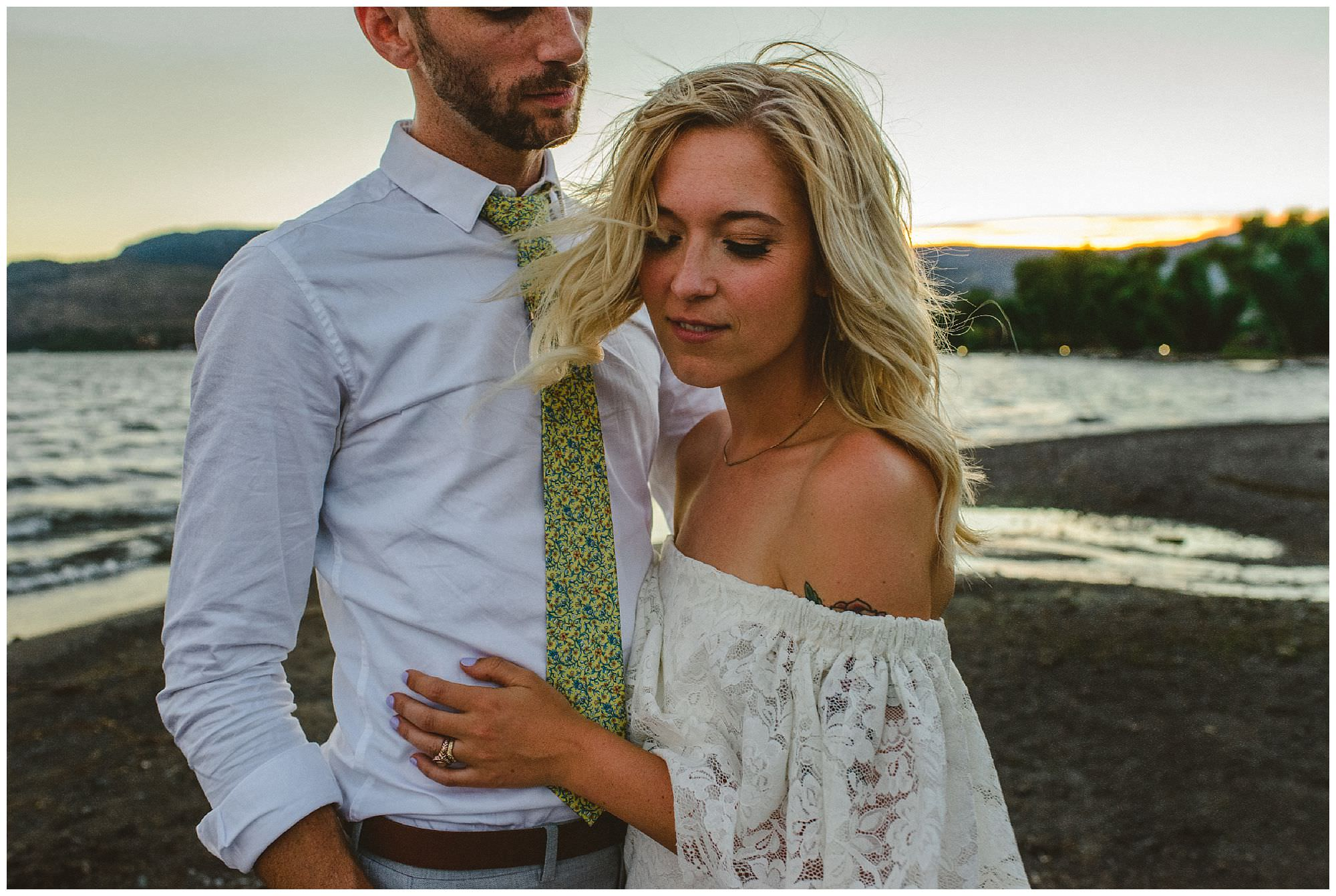 Candid moment with boho bride and groom at their sunset wedding in Kelowna BC