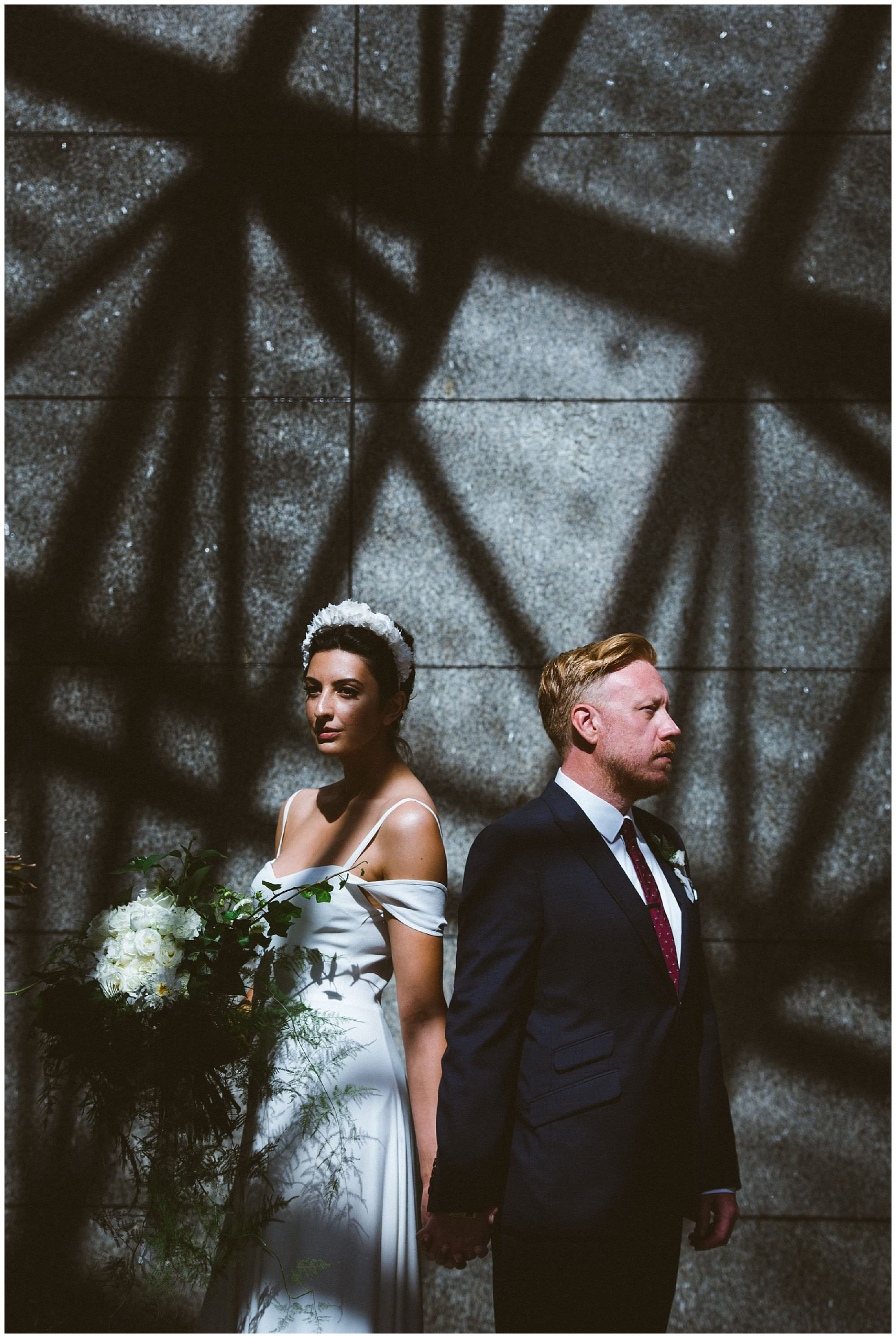 non traditional wedding photo of bride and groom in dramatic light during first look in Vancouver BC