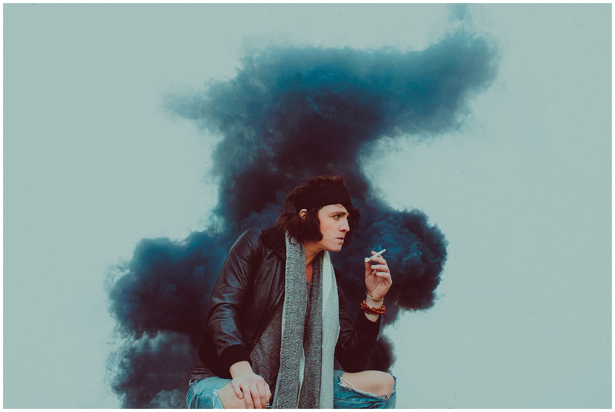Vancouver singer Parker Bossley in front of a smoke bomb by Vancouver photographer Ronnie Lee Hill Photography