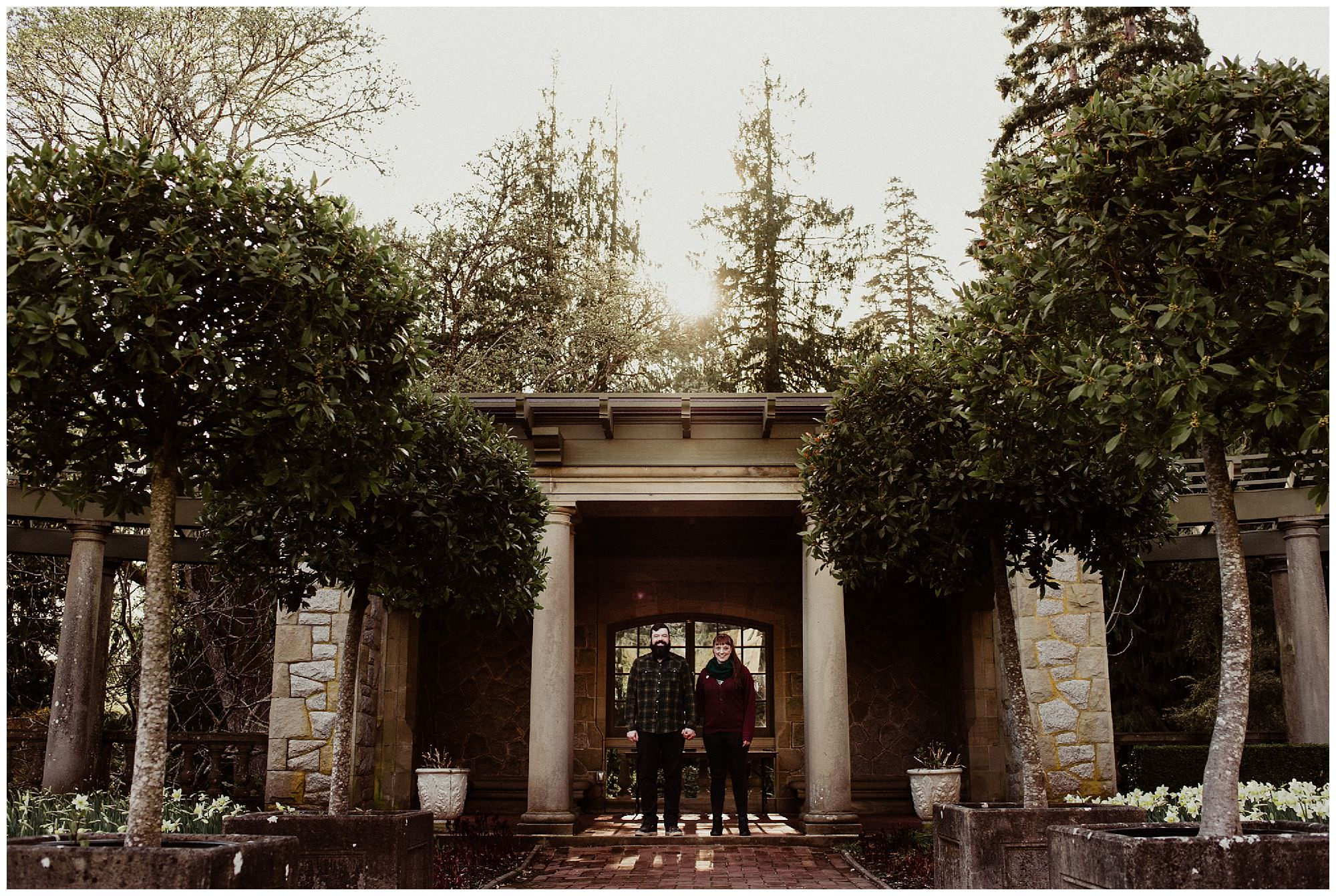 couple-at-sunset-in-garden-engagement-photography-at-Royal-Roads-university
