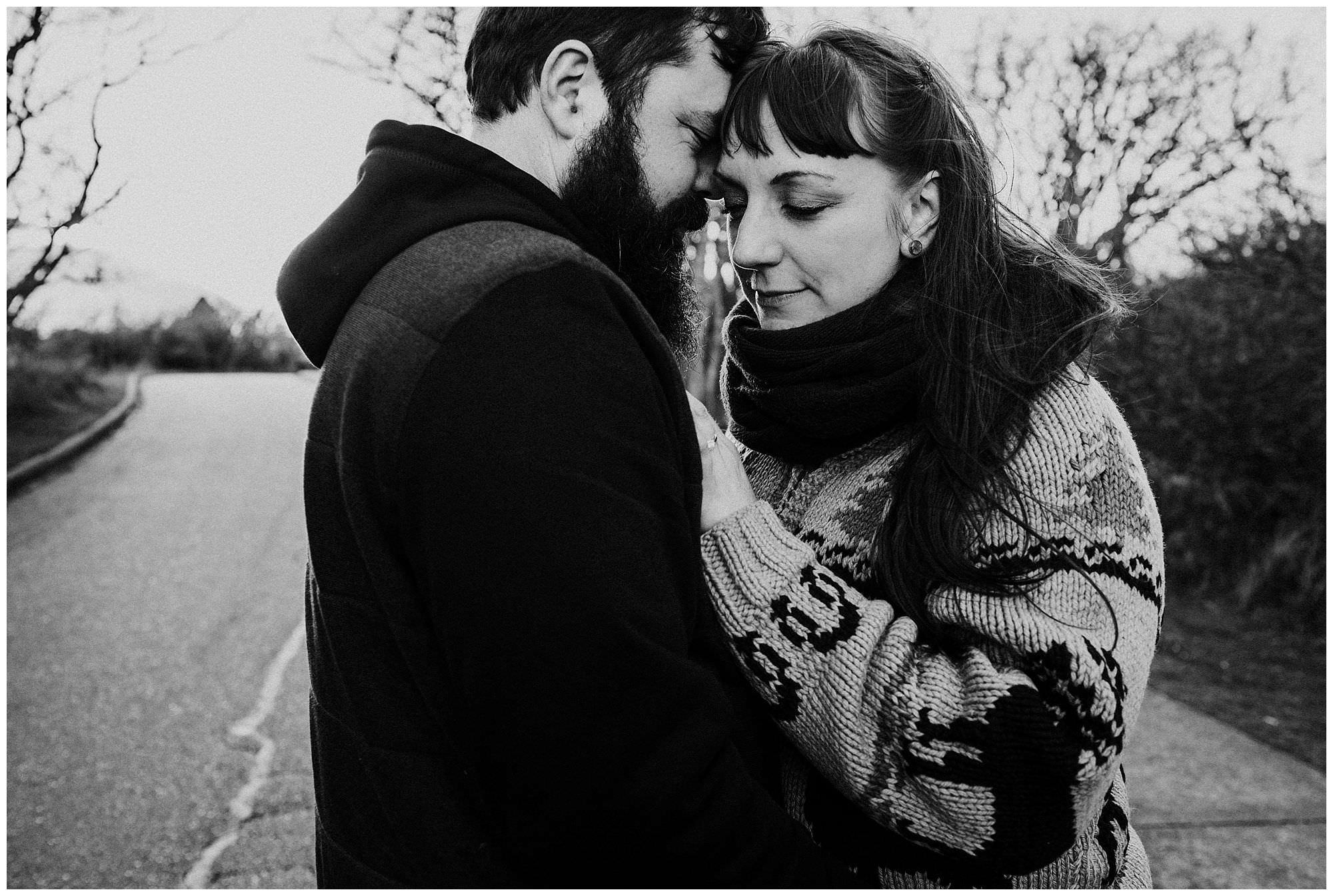 couple-cuddling-on-road-sunset-engagement-photography-at-cattle-point-victoria-bc