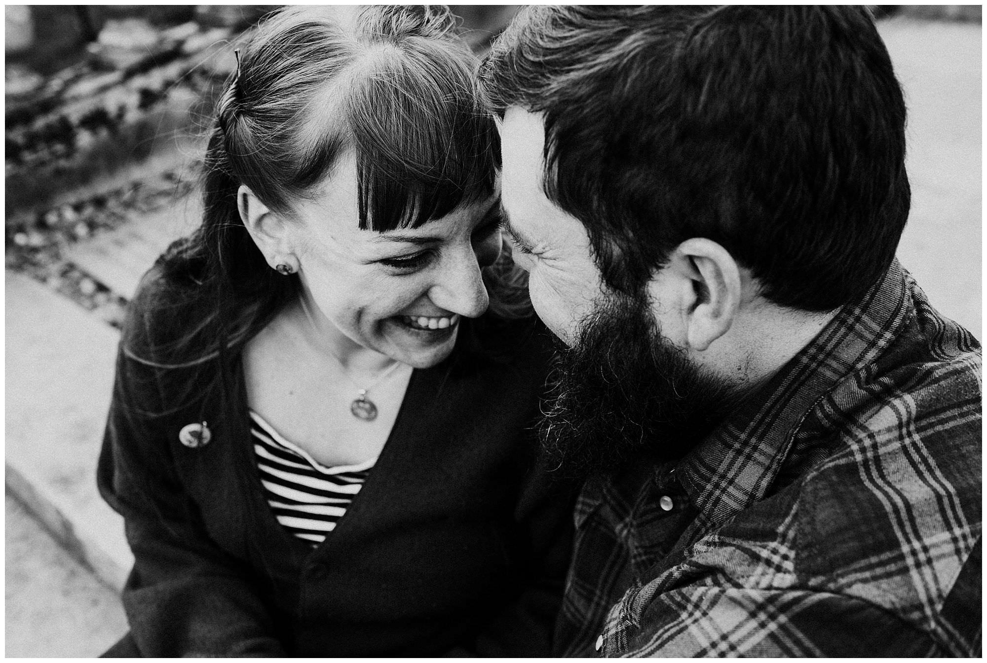 couple-laughing-on-stairs-engagement-session-at-royal-roads-university-victoria