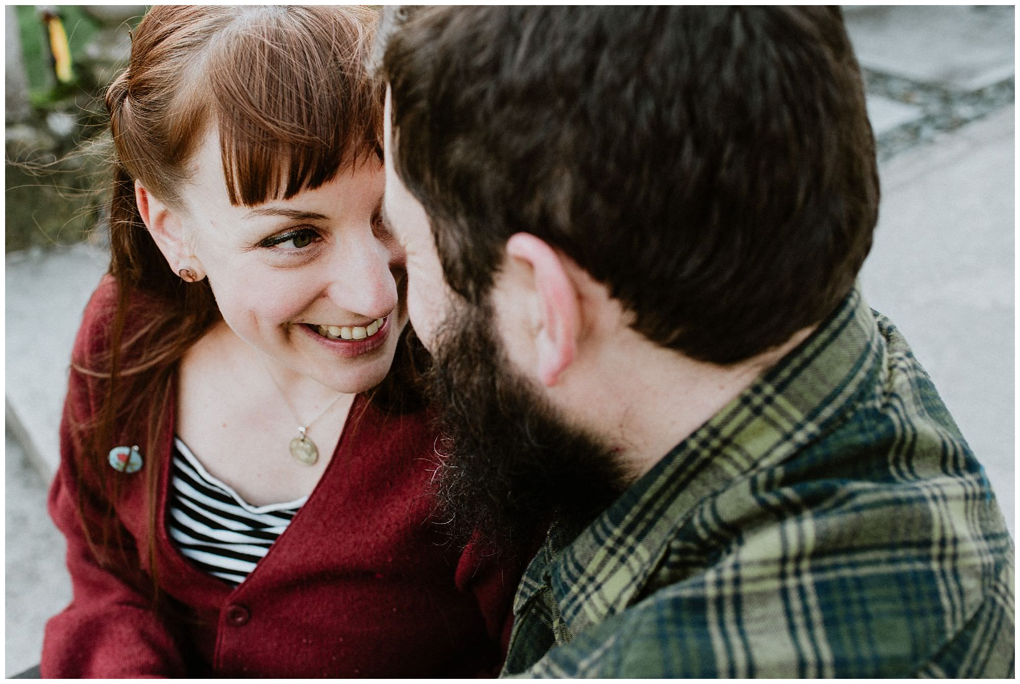 red-heaired-woman-smiling-engagement-session-at-royal-roads-victoria