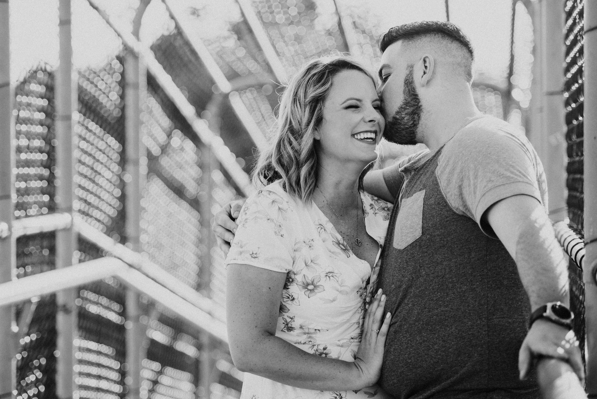 black and white photo of couple laughing east vancouver engagement