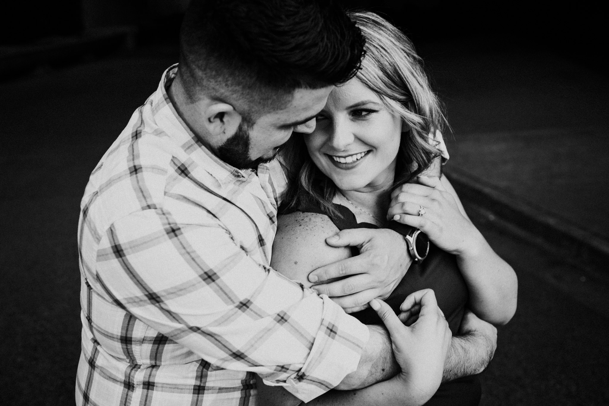 black and white photo of woman being hugged by husband at New Brighton Park