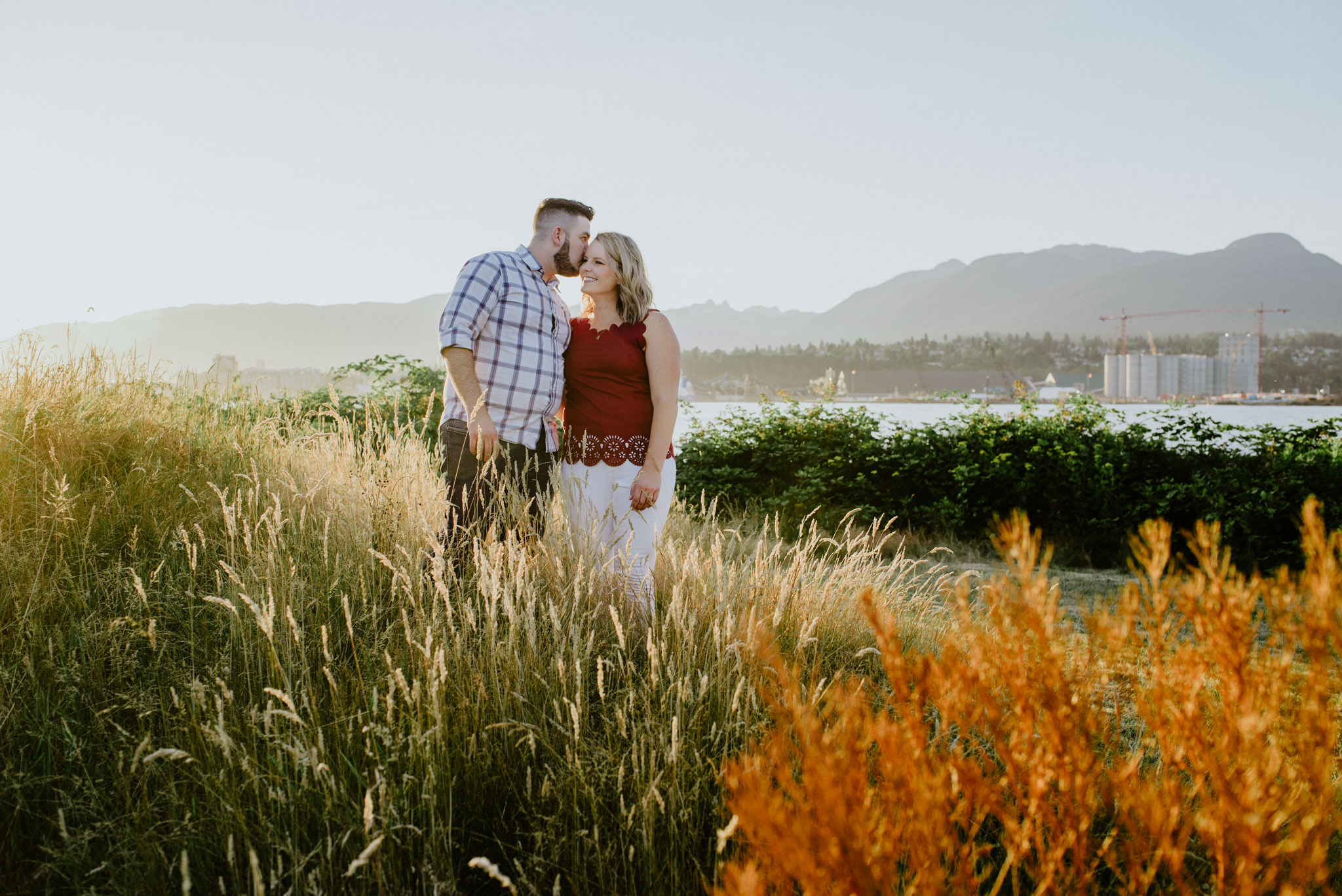 couple kissing at sunset in tall grass New Brighton Park Vancouver