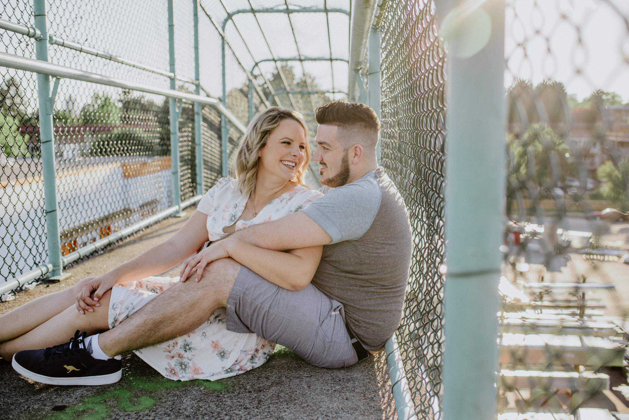 couple sitting on bridge engagement session east vancouver