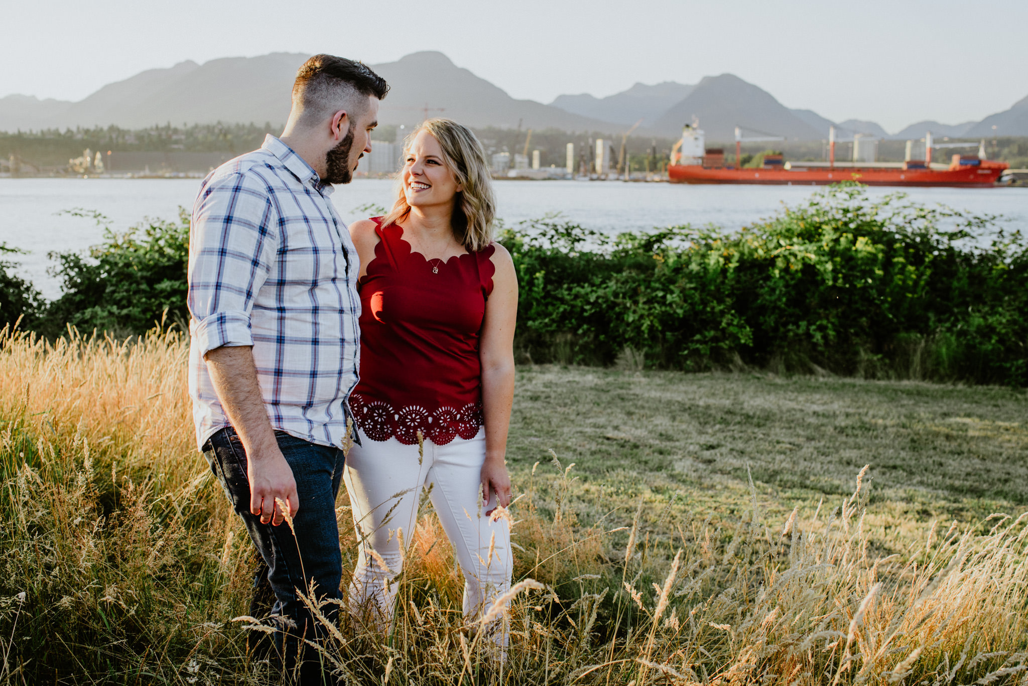 couple walking in long grass New Brighton Beach Vancouver engagement session