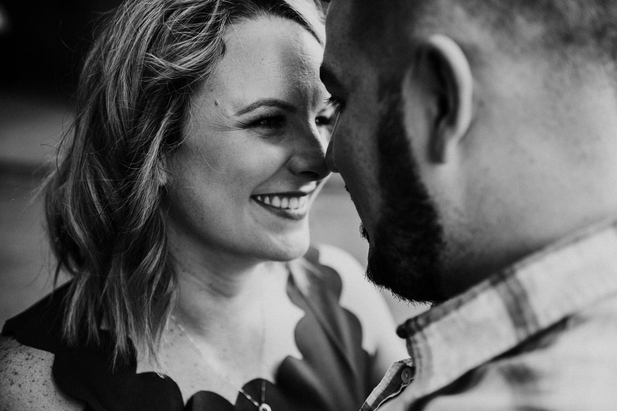 woman smiling at husband Vancouver engagement session