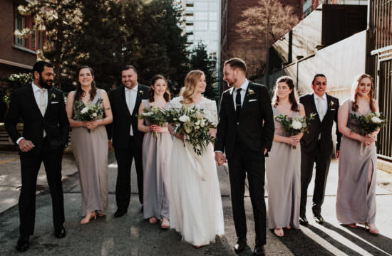 bridal party walking through sunny alley in Yaletown