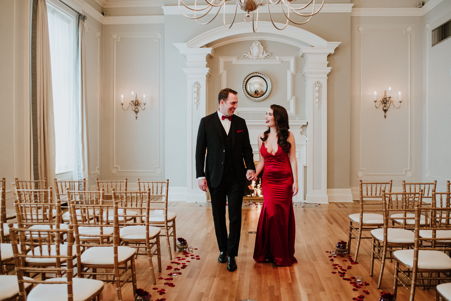 bride in red wedding dress with groom before wedding at The Vancouver Club