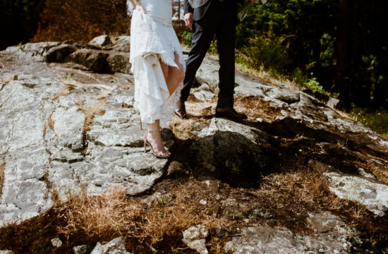 Bride and groom standing on rocks before wedding reception at Homer Street Cafe Yaletown Vancouver