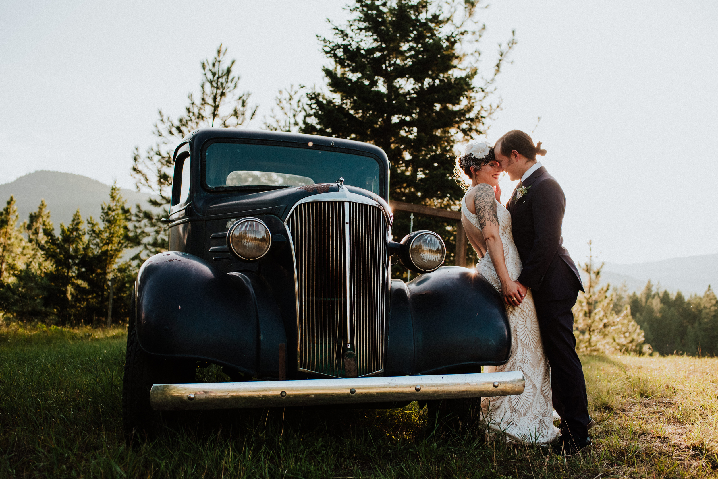 bride and groom in front of vintage truck at shylynn ranch in salmon arm bc